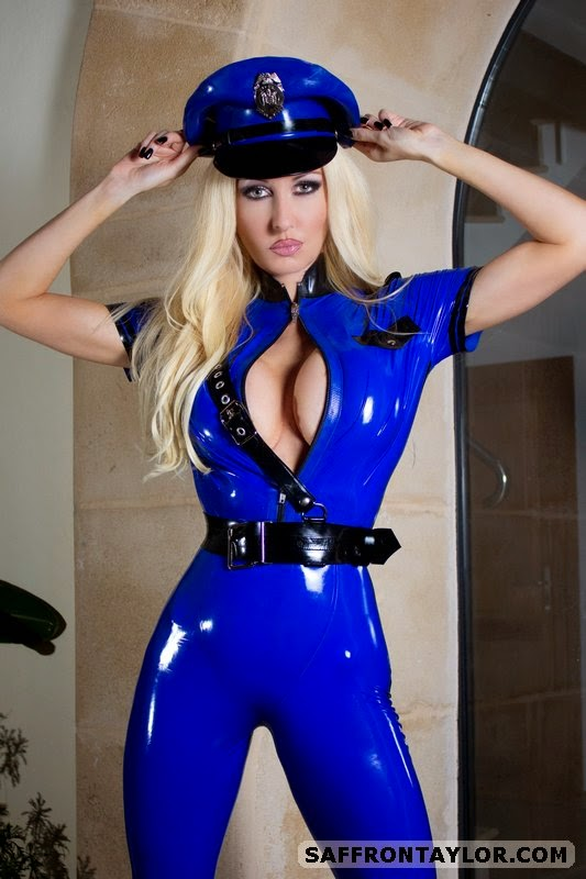 Sexy Blue Latex Catsuit and Black Holster Belt, Sexy Police Girl Saffron Taylor