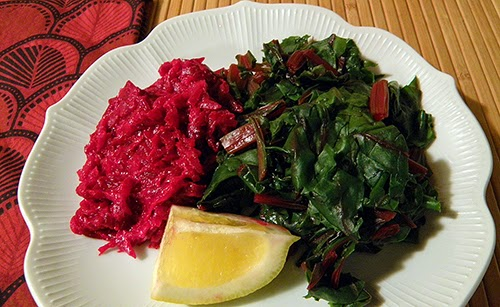 Plate of Buraki and Greens Garnished with Lemon