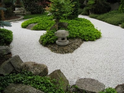 Decora interi jardins decorados com pedras for Separador piedras jardin