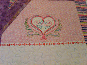 Purple quilt - embroidered heart block