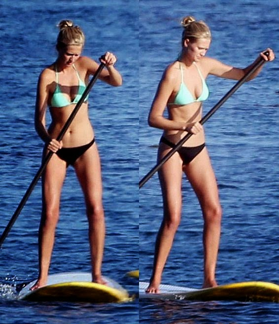 Toni Garrn is good at many things, especially when it comes to looking amazing in a blue two-piece. But her talents don't stop on there as the Supermodel and her boyfriend, Leonardo DiCaprio decided to try out paddle boarding on their Malibu vacation on Sunday, August 11, 2014.