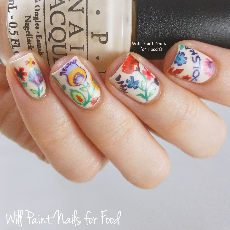 Wycinanki-inspired freehand nail art