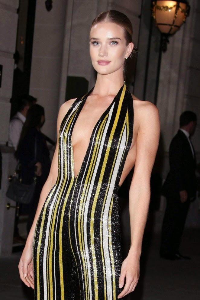 Rosie Huntington-Whiteley wears a plunging Balmain jumpsuit to the CR Fashion Book #5 Paris Launch Party