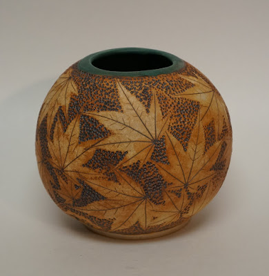 Beautiful maple leaf imprinted and stained pottery vase by Lily L.