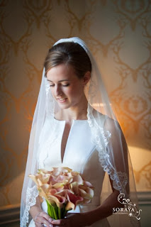 Bride with veil and holding a bouquet of flowers