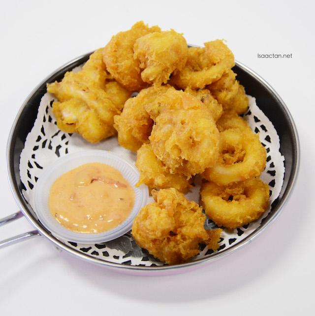 Beautiful calamari rings on a pan