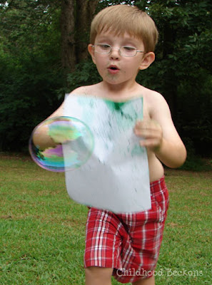Chase colorful bubbles to make art