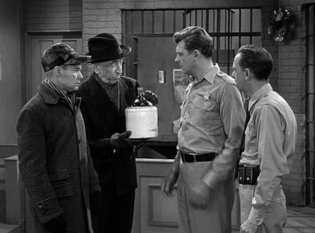mr weaver holds the evidence a jug filled with spirits made by sam to make his christmas merrier - Andy Griffith Show Christmas Story