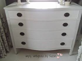 White dresser with black hardware