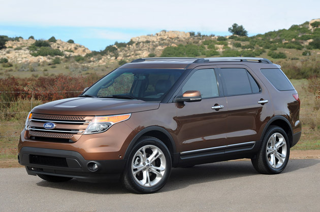 Brown 2012 Ford Explorer front three-quarters view against rocky hills