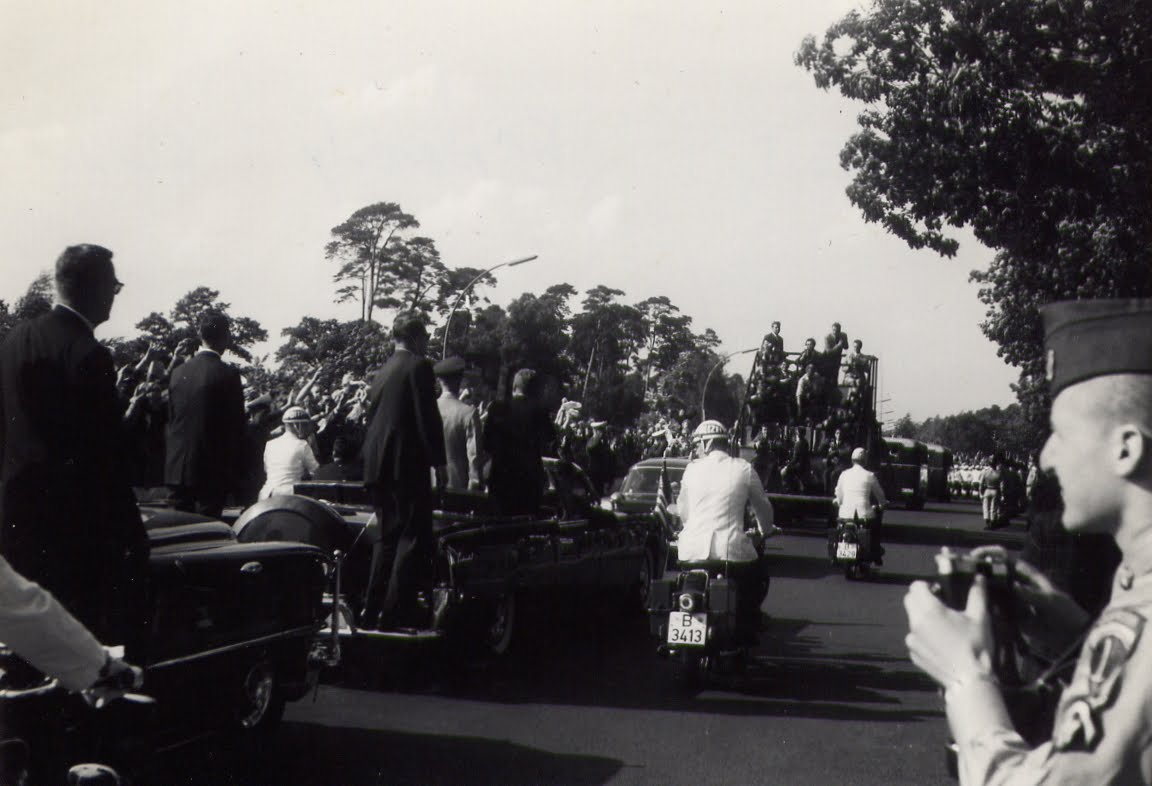 JFK motorcade- agents on rear of limo, press/ photographers in front, etc