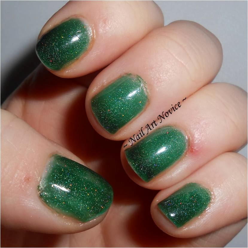 Swatches of Black Cat Lacquer-Evergreen, transitioning state