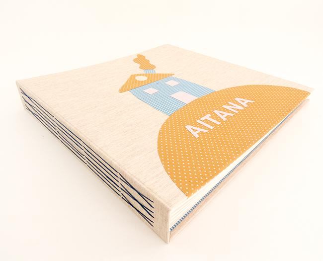 encuadernación cosido visto o long stitch para álbumes infantilespersonalizados