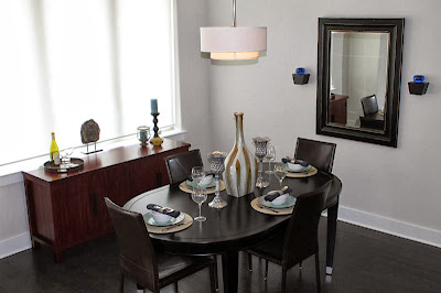 elegant and classy black dining with reflective accents
