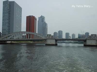 Bridge and buildings together during the Sumida River cruise, Tokyo - Japan