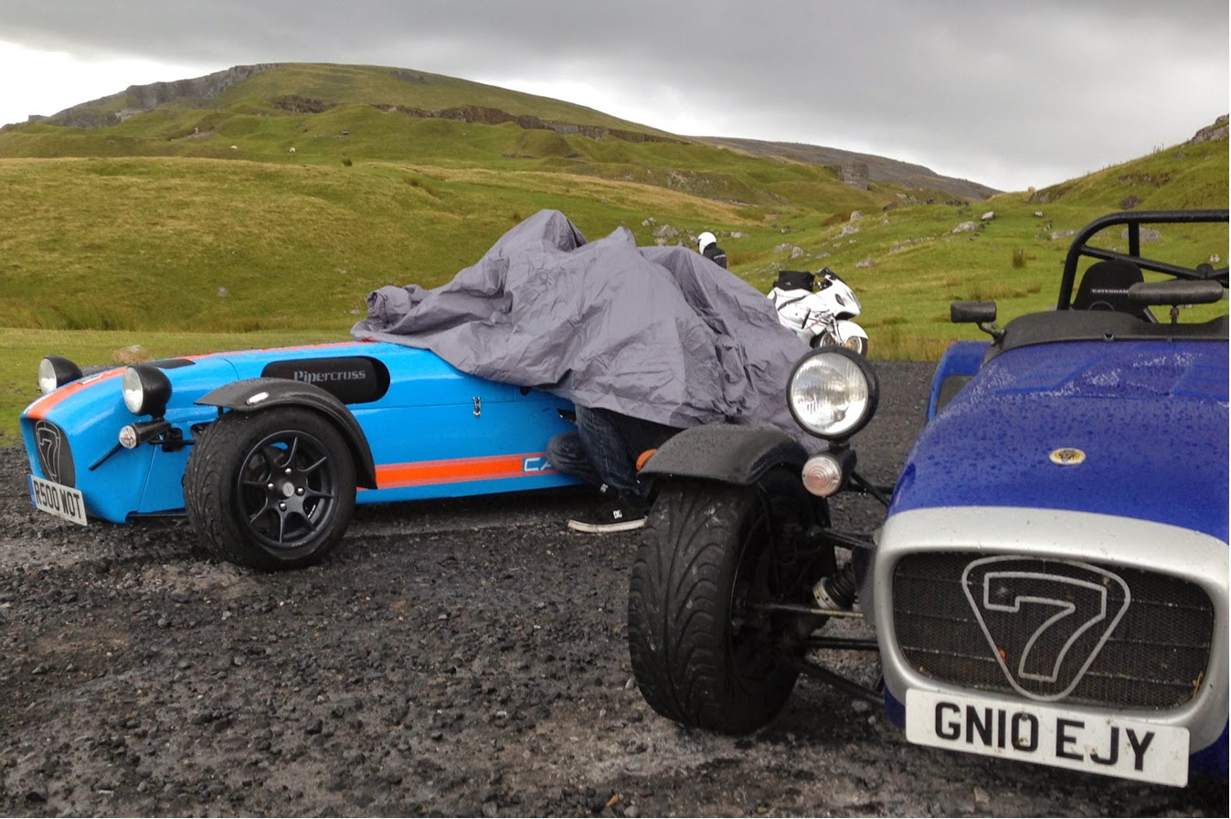 Three people taking cover from the rain in a Caterham R500... or are they dogging?!?