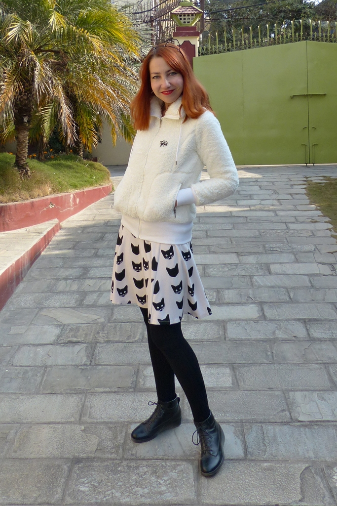 Fun black and white outfit with fur effect jacket and cat print skirt