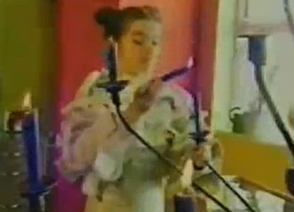 Bjork 1992 MTV Cribs house tour lighting her the blue candles on her chandelier