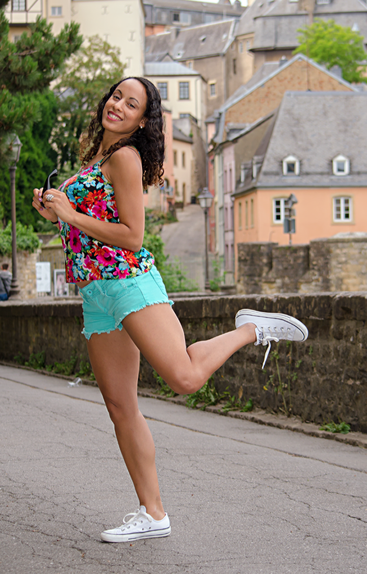 Strolling in mint green shorts in Europe