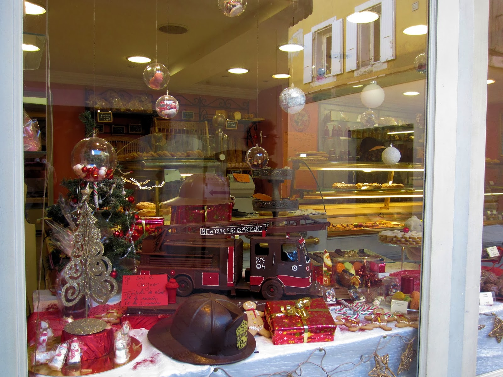 Christmas in Provence - window shopping - Chocolate art that sure to appeal to any young future firefighter
