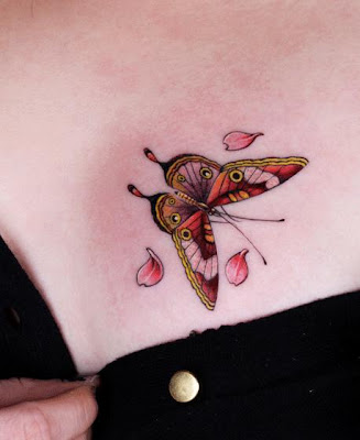 butterfly tattoo on the chest with petals