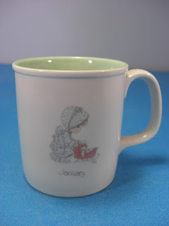 http://bargaincart.ecrater.com/p/16350656/january-birthday-mug-precious-moments?keywords=january