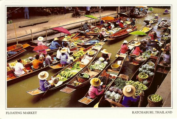boats with produce in floating market