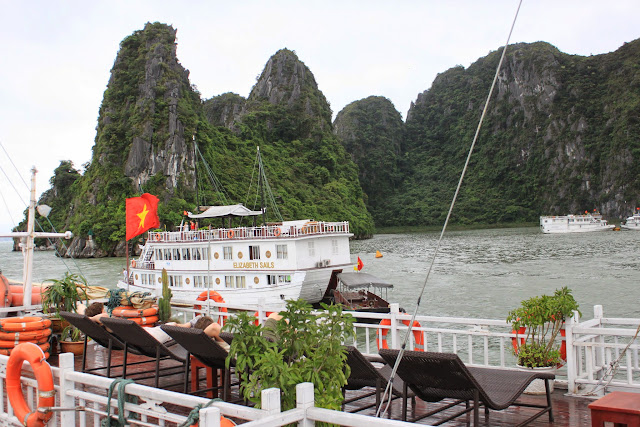 Looking over Halong Bay from top deck of Alova Cruise along Halong Bay in Hanoi, Vietnam
