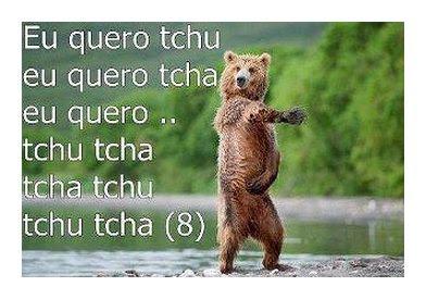 Urso cantando eu quero tchu, eu quero tcha.