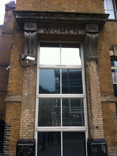 Ghost sign to the women's entrance to the Providence Row Night Shelter and Refuge, Spitalfields, London