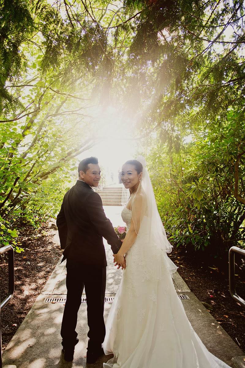 Miki and Luis walk the paths near Snoqualmie Lodge after their wedding ceremony - Kent Buttars, Seattle Wedding Officiant