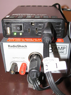 Powerline 200/400 Watt Mobile Inverter plugged into 12V power supply to test with