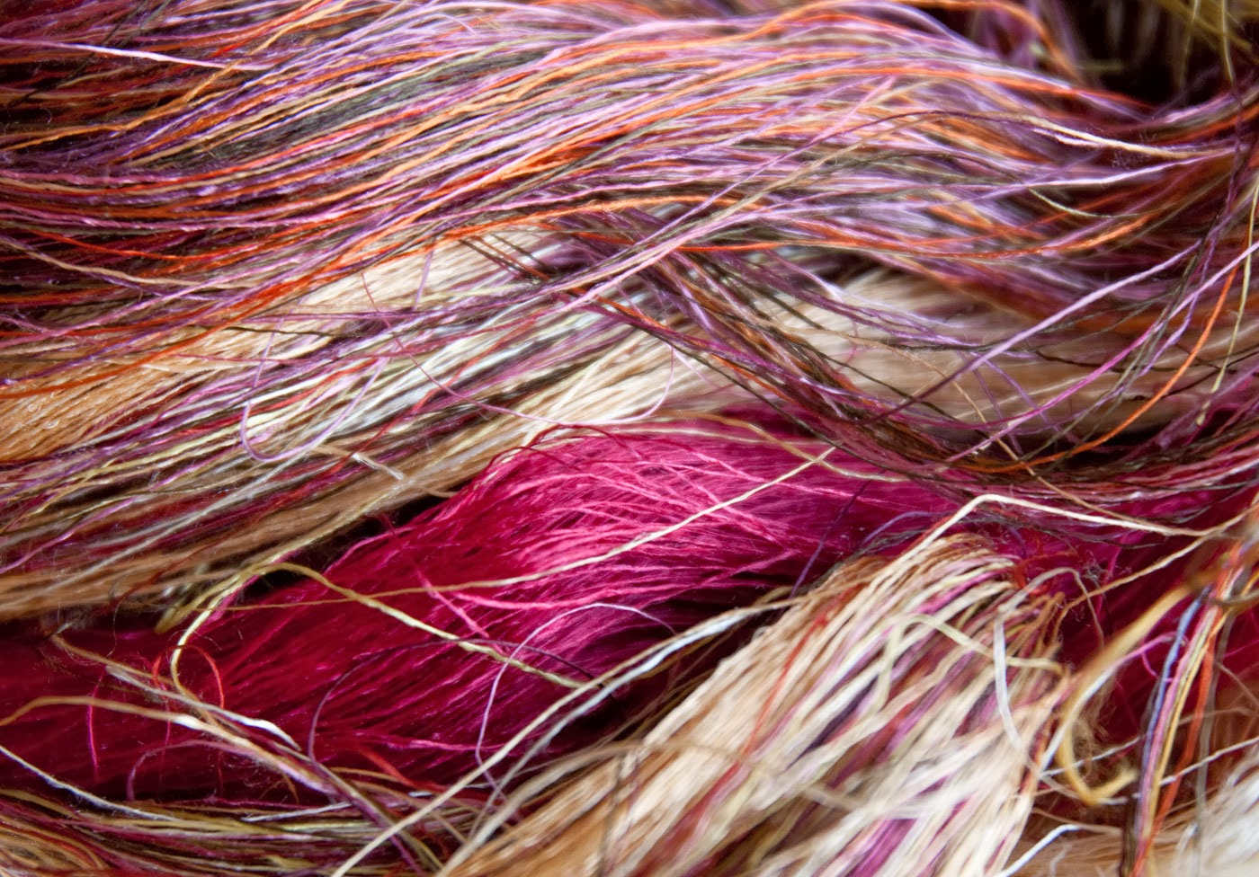 Naturally dyed silk yarns derive their colours from nature and will be transformed into stunning, handwoven silk creations.