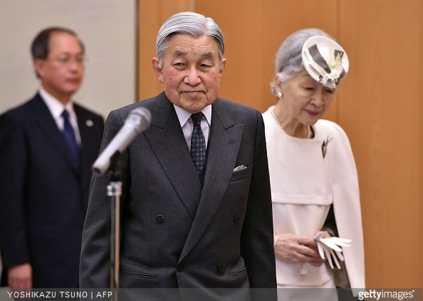 Japanese Emperor Akihito and Empress Michiko enter a room to say good bye to Crown Prince Naruhito and wellwishers as they leave to Palau at the Tokyo International Airport
