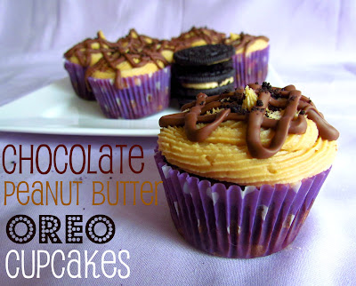 chocolate cupcakes in purple liner with peanut butter frosting and chocolate drizzle on purple background