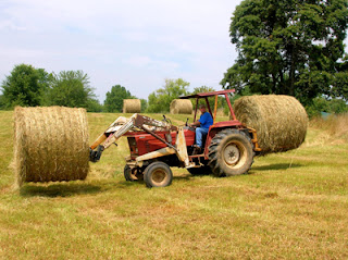 moving two round bales