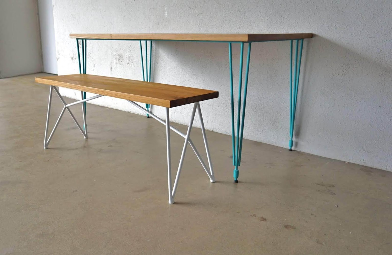 dining table with 3 pin legs in turquoise blue and an interesting