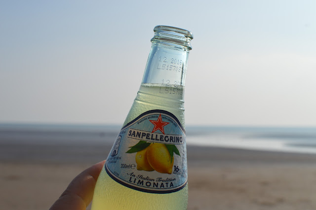 San Pellegrino Limonata Bottle on Beach