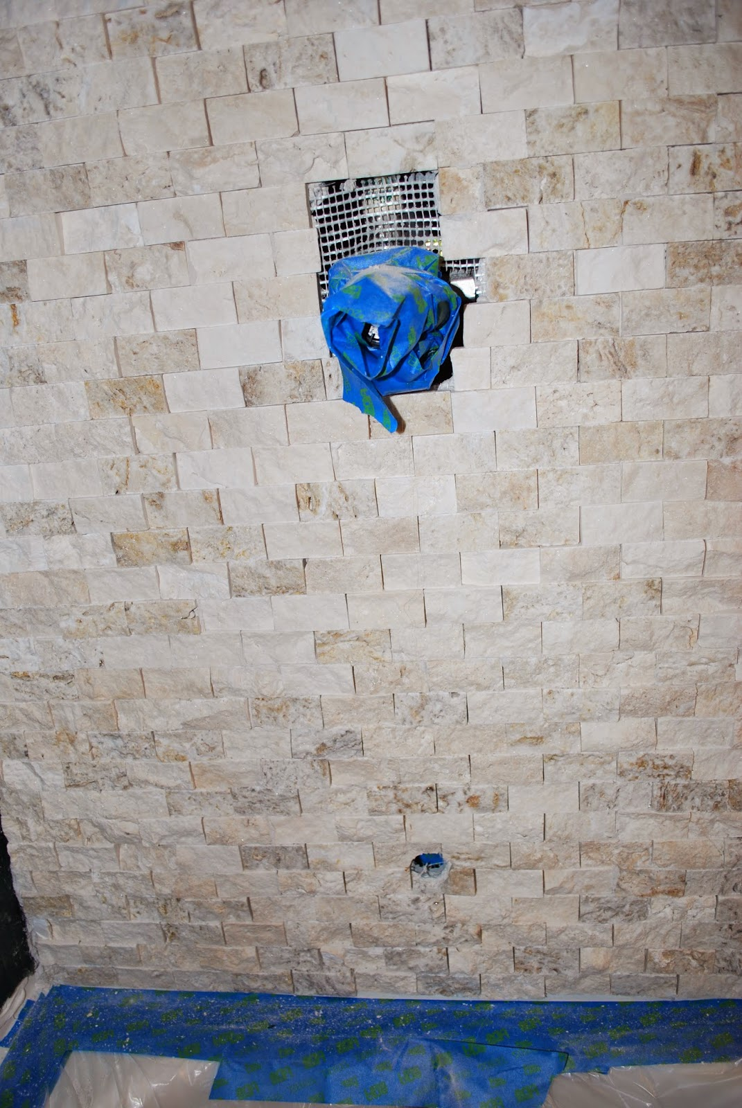 how to cut stacked stone tile for plumbing in bathroom