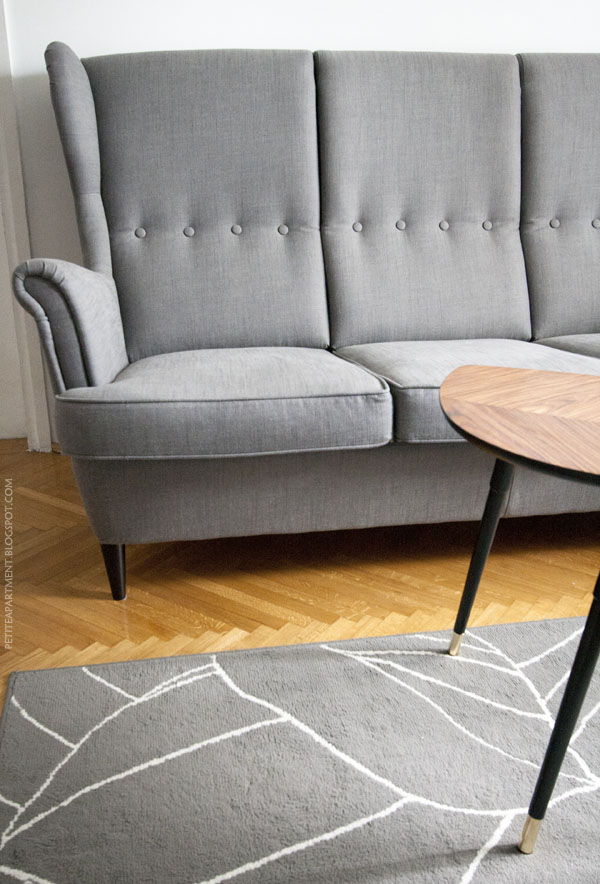Ikea Strandmon grey sofa, grey Gislev rug and Lovbacken side table