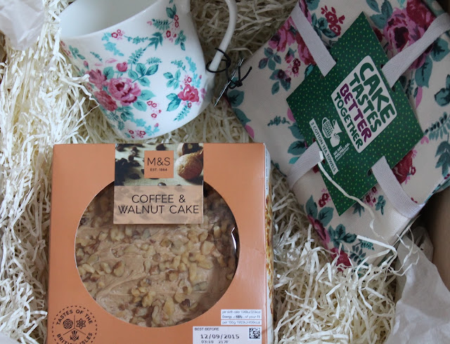 M&S Macmillan coffee morning products floral bone china mug, floral tea towels and coffee & walnut cake