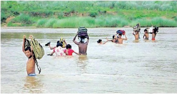 Childrens Going To School By Crossing A Bahuda River