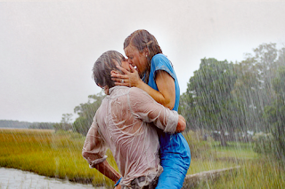 couple hugging and very romantic kiss in rain