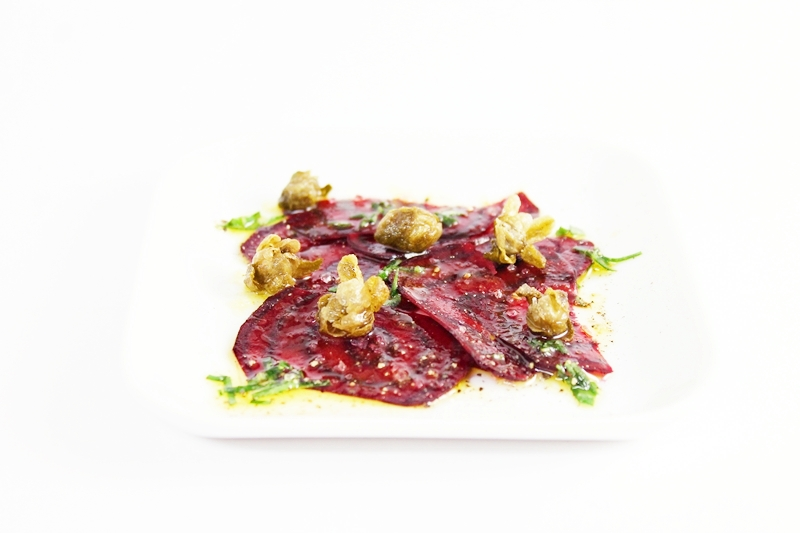 Add the capers to the beets and drizzle the vinaigrette on top, serve.