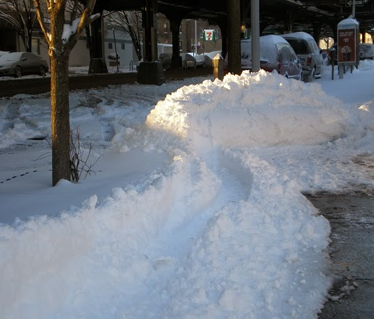 snow drifts on street