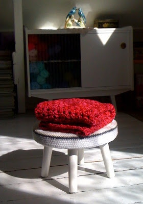 crochet throw, pink, red, stool, white floor
