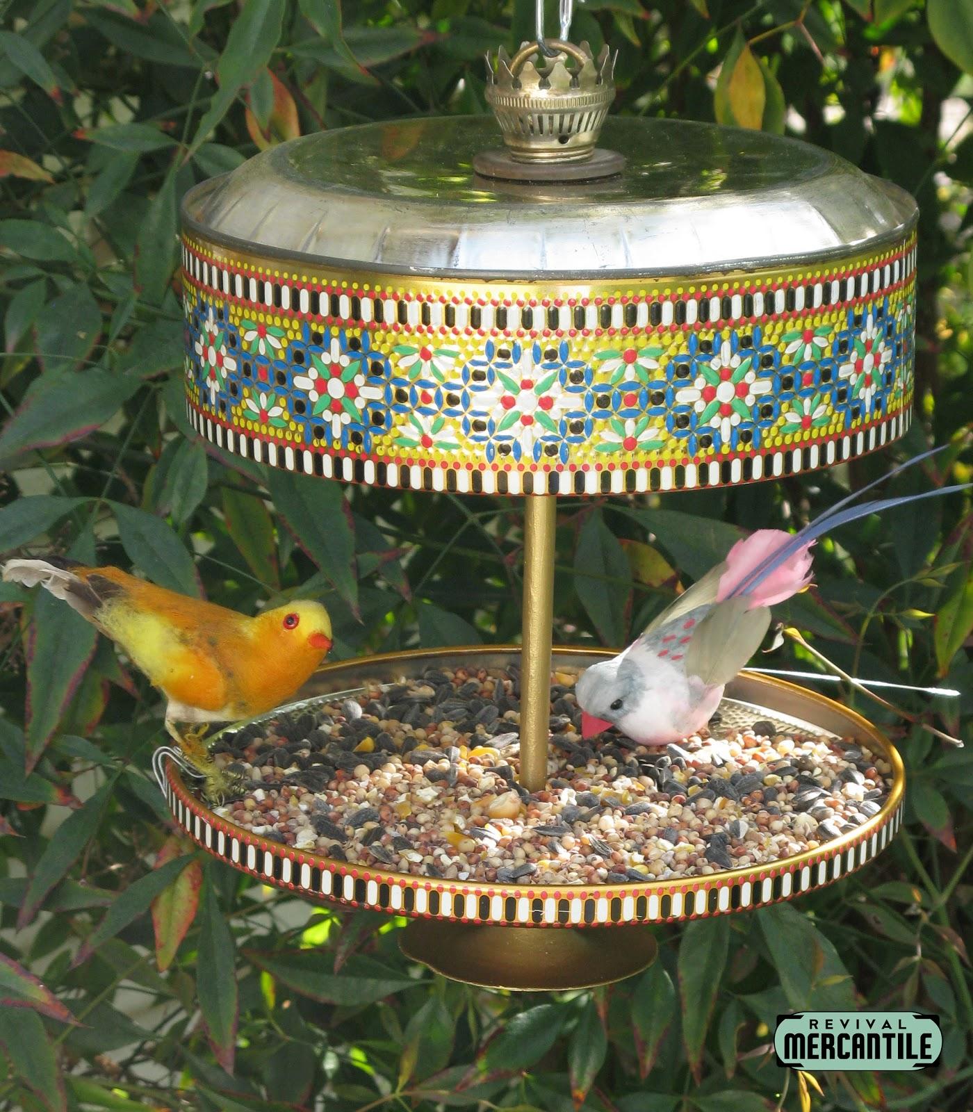 Revival mercantile vintage candy tin bird feeders for Bird feed tin