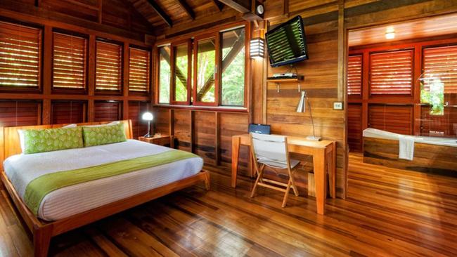 Estilo rustico cabana rustica de madera en dominica for Modelos de cabanas rusticas