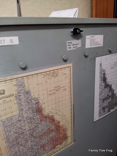 maps hanging on map cabinets