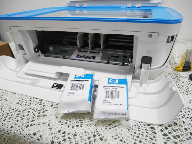 The printer comes with 2 ink cartridges, one black and one colour cartridge